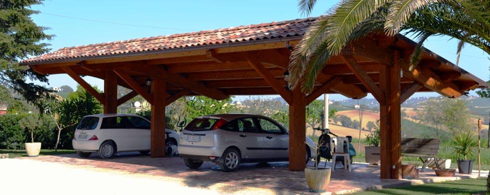 Carport carport in legno a struttura unica euroistal for Coperture in legno per auto usate